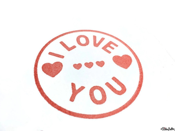 Close Up of I Love You and Hearts Stamped Image on a Simple Red and White I Love You, Hearts and Arrow Hand Stamped Square Card - Love is on the Cards! at www.elistonbutton.com - Eliston Button - That Crafty Kid